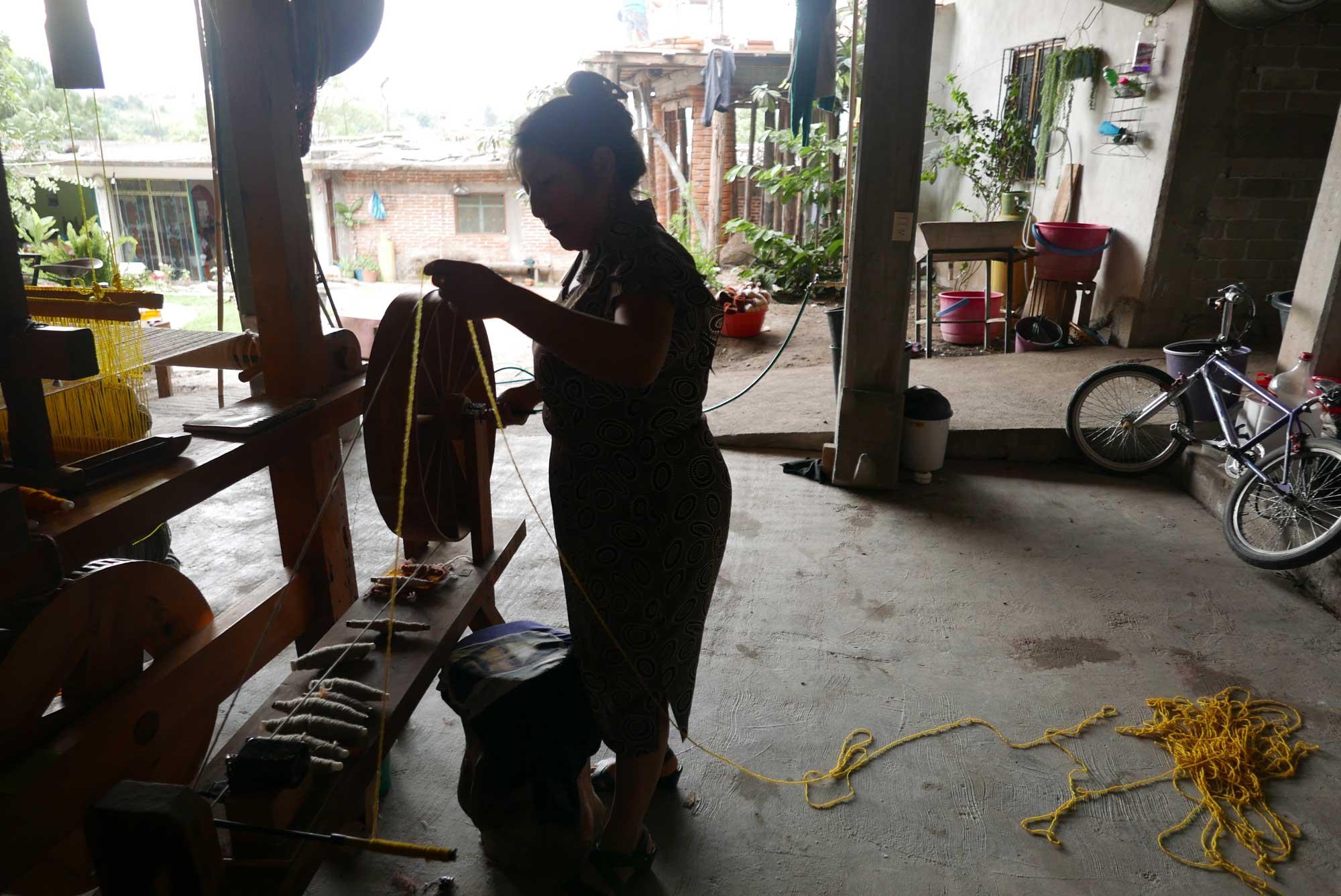 Artisan Spinning Wool for weaving Zapotec Rug Teotitlan de Valle Mexico